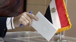 An Egyptian expatriate living in Lebanon casts her vote in a referendum on the new Egyptian constitution at the Egyptian embassy in Beirut